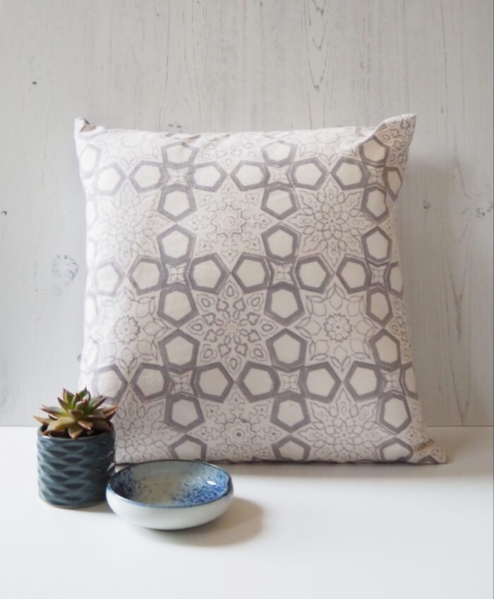 block print patterned cushion
