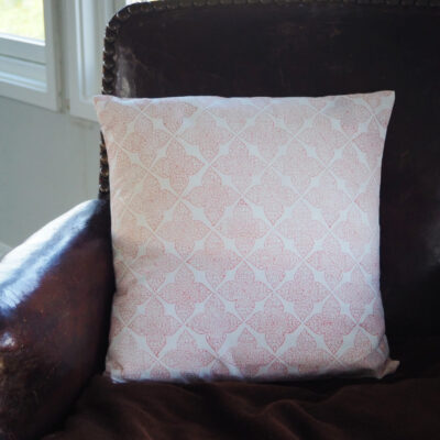 hand block printed cushion in coral terracotta pink