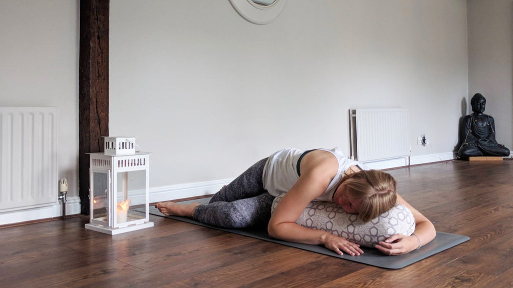 reclined twist yoga pose