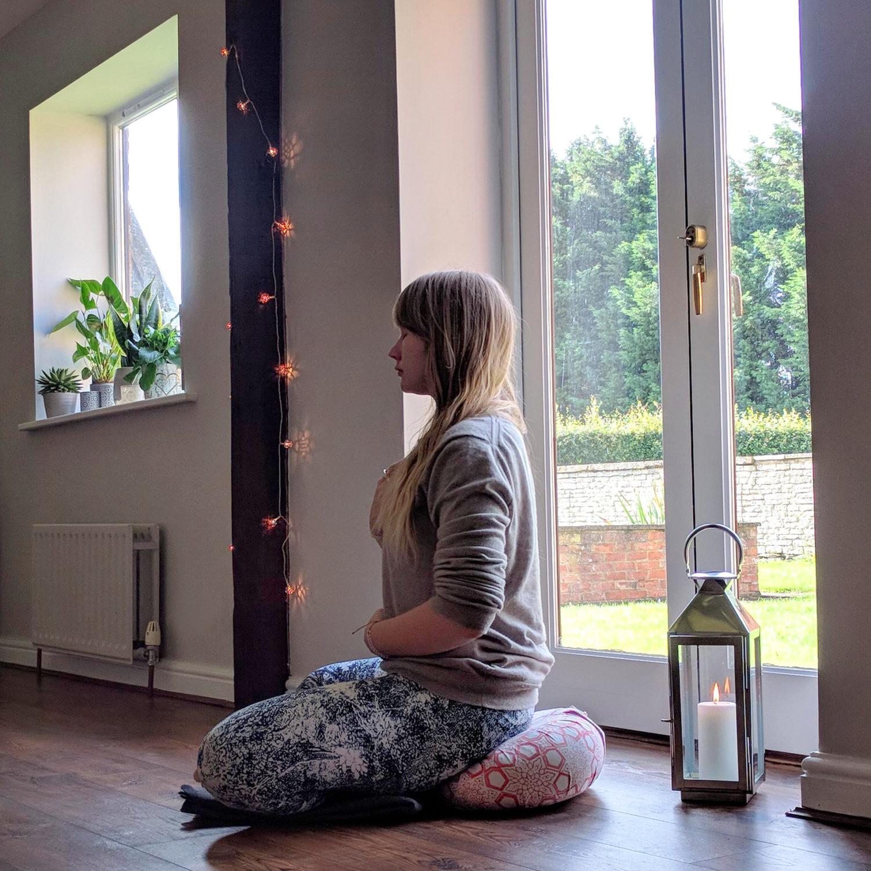 breath awareness sat on a meditation cushion