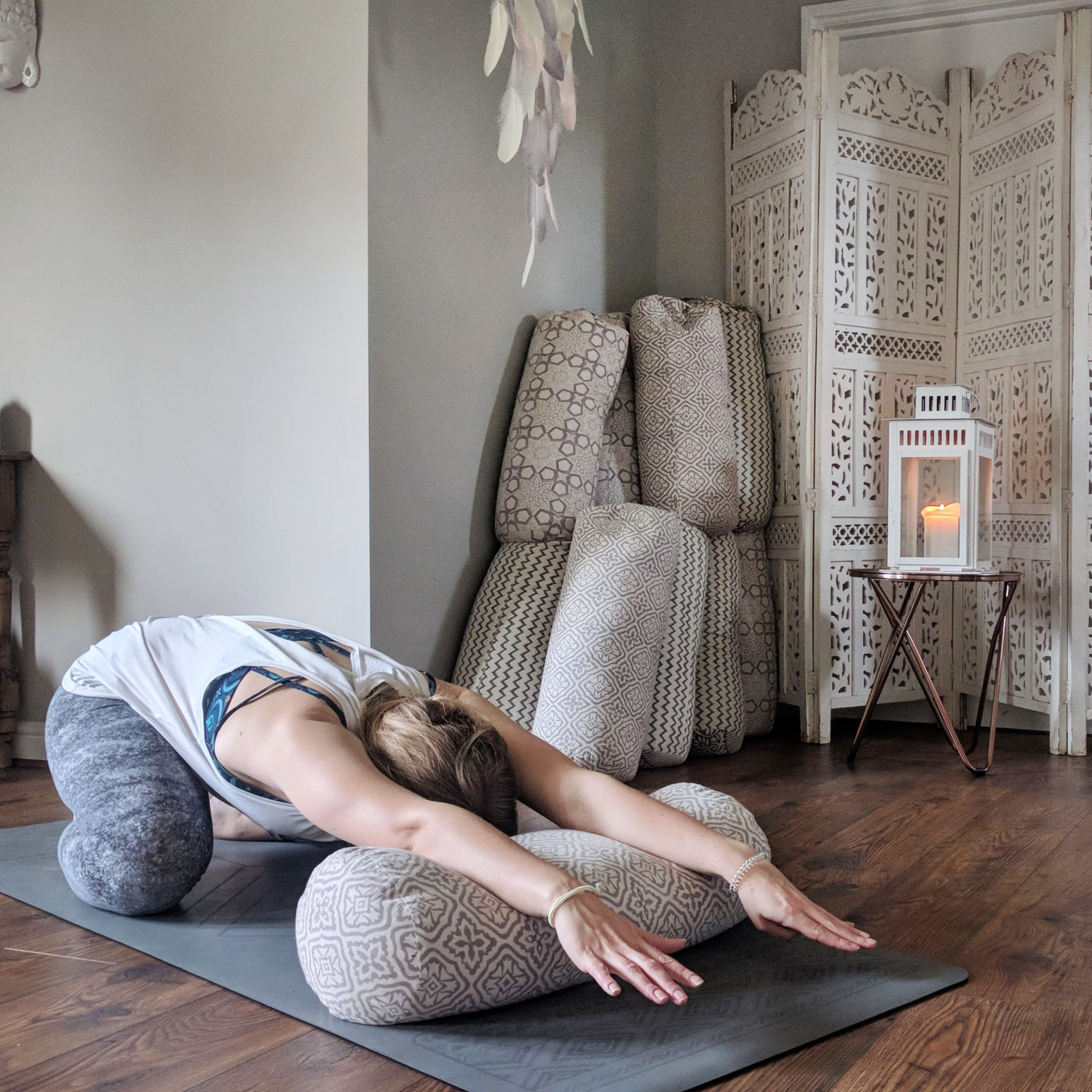 extended childs pose with arms on bolster