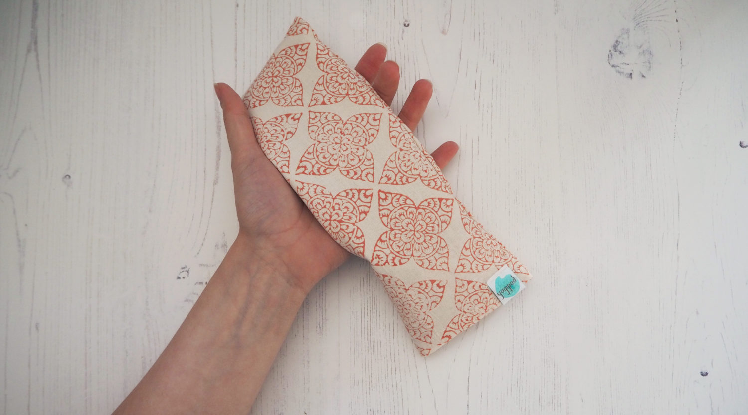 eye pillow resting on a hand